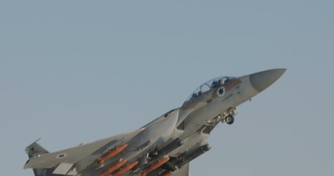 F-15 attack fighter taking off for a bombing run during an airshow