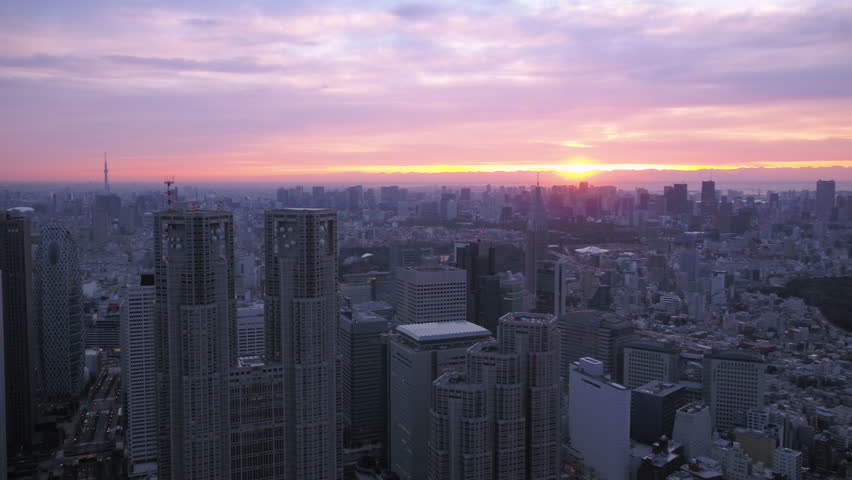 Japan Tokyo Aerial v29 Flying over downtown Shinjuku panning with cityscape views sunrise