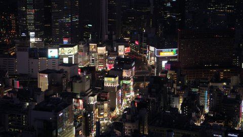 Japan Tokyo Aerial v68 Birdseye view flying low over famous Shinjuku area panning down at night 2/17