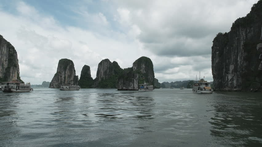 A tracking shot of part of the tour boat fleet sailing on halong bay, vietnam | Shutterstock HD Video #28644715
