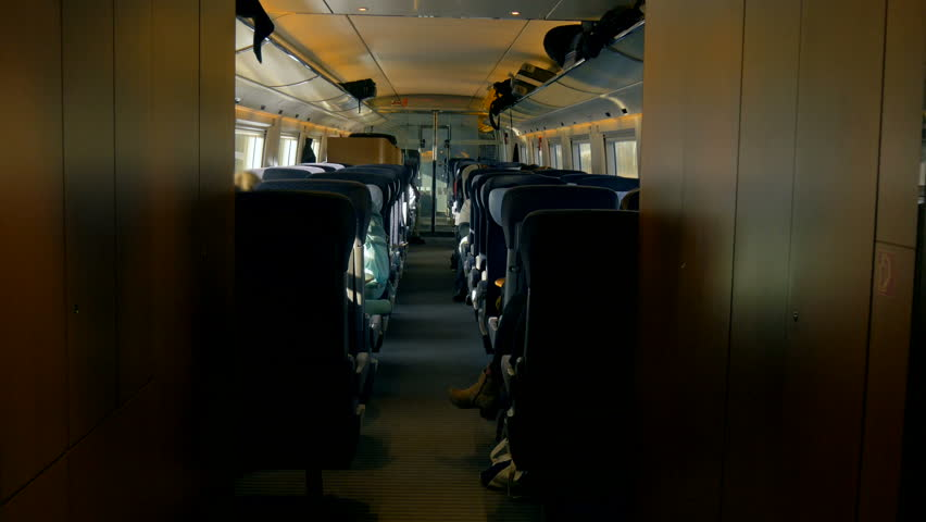 The interior of a passenger train cabin is filmed as its automatic glass doors slowly begin to close.  | Shutterstock HD Video #28654765
