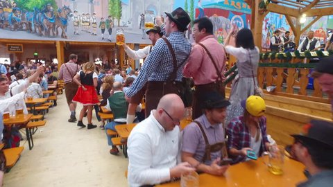 Munich, Germany-2010s: Drunken people drink, sing and celebrate at Oktoberfest, Germany.