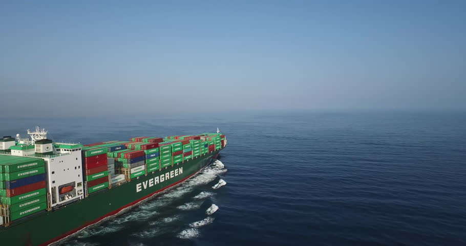 Pacific Ocean-2010s: Remarkable aerial footage flying in front of a cargo container ship on the high seas. #28675495