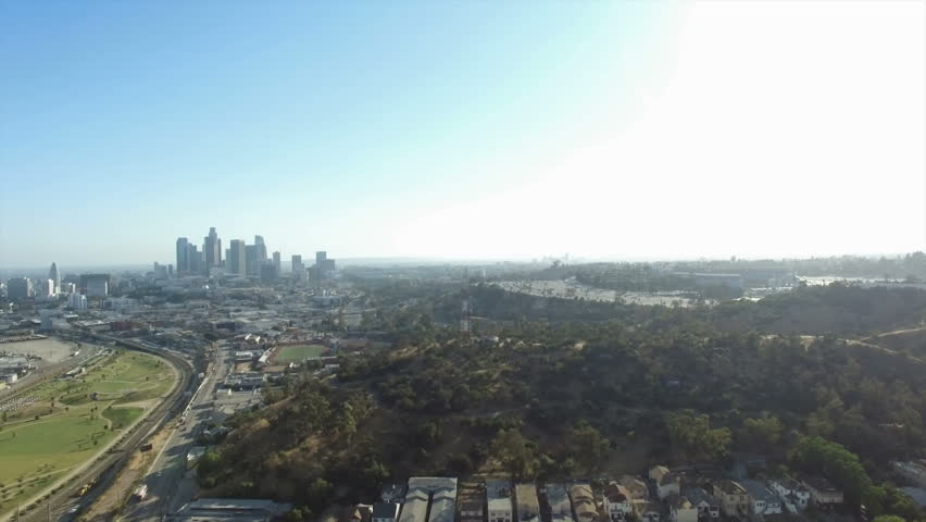 Aerial pedestal down of Los Angeles view behind Radio Hill | Shutterstock HD Video #28682695