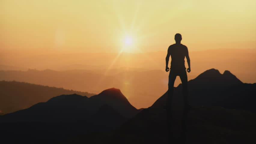CG created silhouette animated in a victory pose above a mountain. | Shutterstock HD Video #28699465
