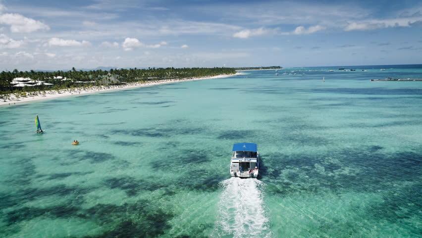 Speed boat or yacht sailing in the caribbean sea near Punta Cana beach