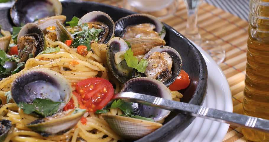 Dolly push out close up view of delicious Italian spaghetti alle vongole (clams)