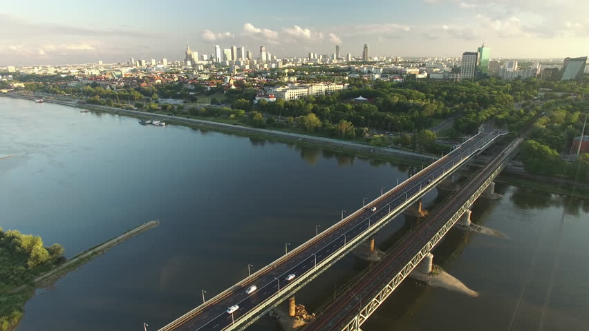 Beautiful aerial footage during the sunset on a Vistula's boulevards, Gdanski's bridge and city skyline view.
