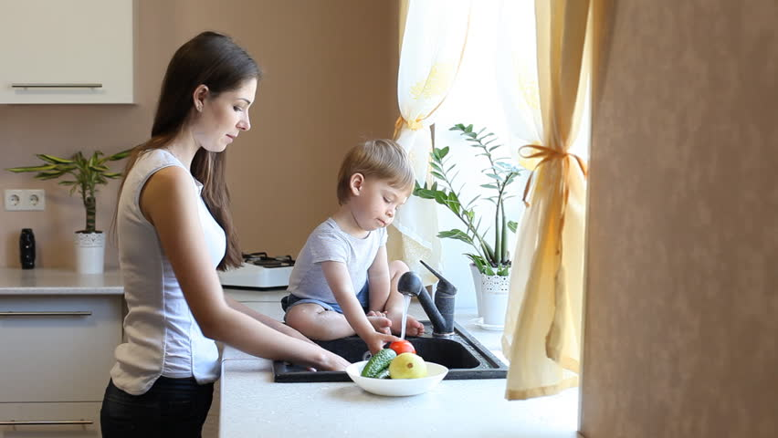 kitchen mom and son washing fruits and vegetables