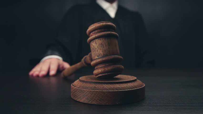 Judge Knocking wooden gavel | Shutterstock HD Video #28776625