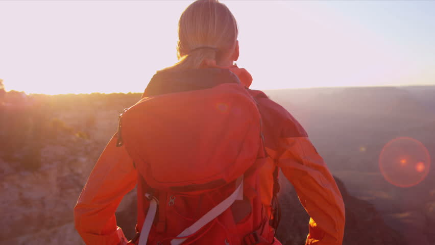 Female motivated by her achievement viewing canyon sunset, Shot on Red Epic | Shutterstock HD Video #2877685