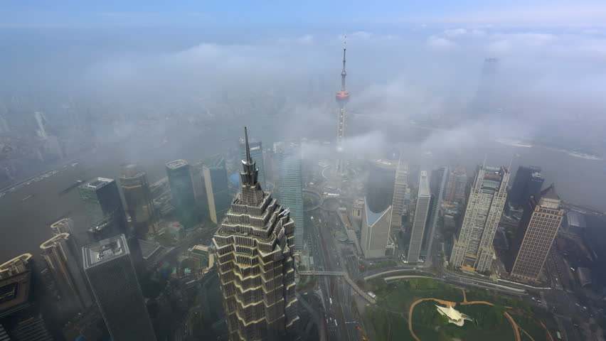 "The modern buildings in Shanghai China viewed from skyscraper of Pu-dong. Over the sea of clouds. - >>> Please search similar: "" ShanghaiSkyline "" . The Newest Featured Similar Clip: 1020262945 