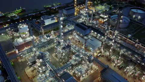 4K Night aerial shot of off oil refinery