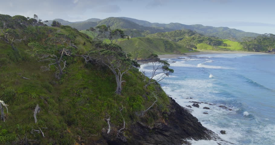 Aerial flying over the farmland and bay of islands in northland, new zealand
