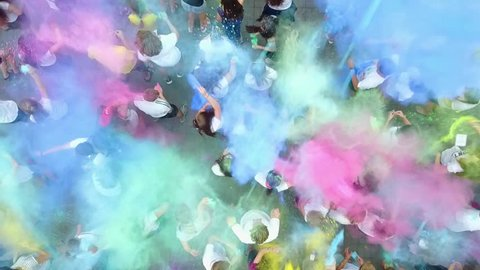Vinnytsia, Ukraine - June 13, 2017: Birthday of Vinnitsa Central City Recreation Park. People throwing colorful paint and powder during holi festival celebrations.