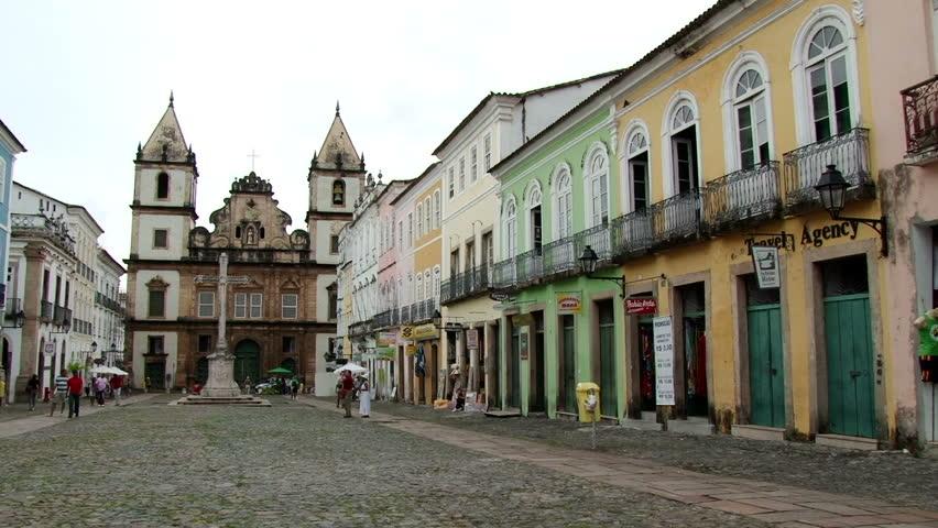 Wide shot of Largo do Cruzeiro de São Francisco with Iglesia San Francisco behind. Pelourinho district in Salvador de Bahia, Brazil