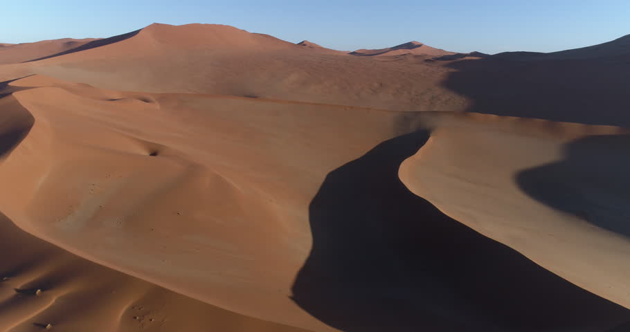 Aerial panning view of  one of the vast sand dunes in the Namib desert   Shutterstock HD Video #28866151