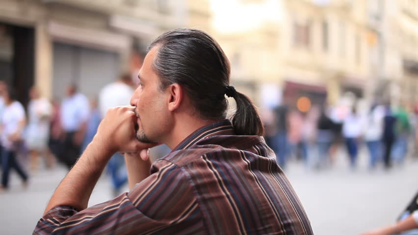 sad man sitting on the street time lapse