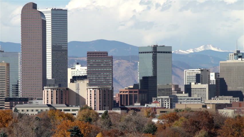Slow zoom-out of the Denver, Colorado skyline, with City Park in the foreground. HD 1080p.