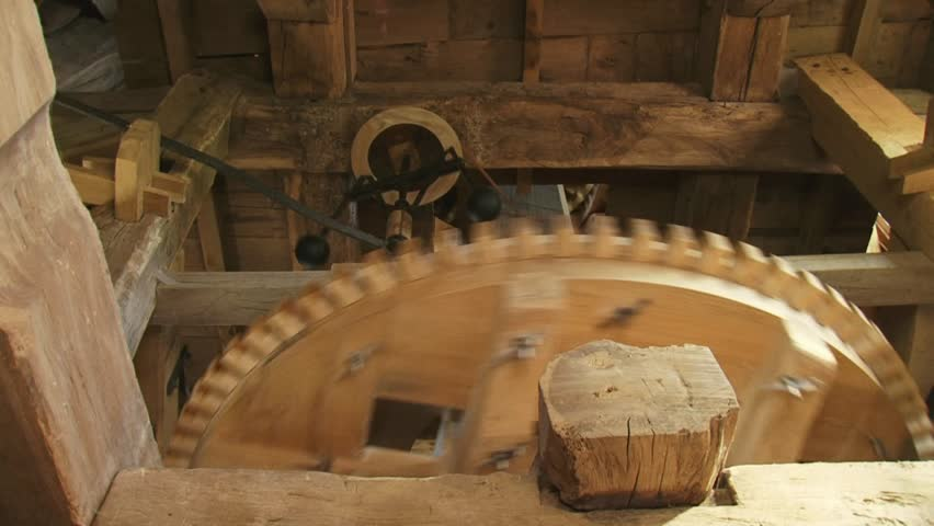 windmill interior - wooden cogwheels turning - frog view