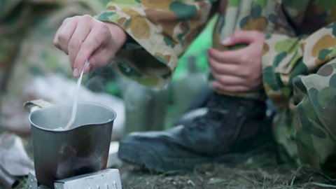 Soldier eating in forest