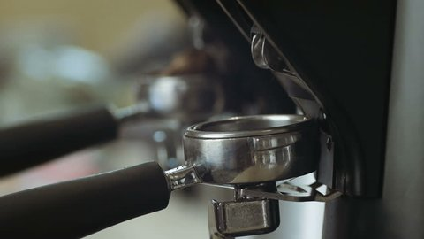 Barista makes coffee preparation using a coffee grinder machine