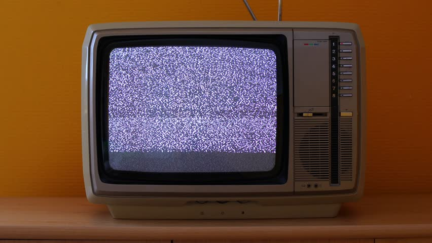 No signal just noise on a small TV in a dim room | Shutterstock HD Video #28930615