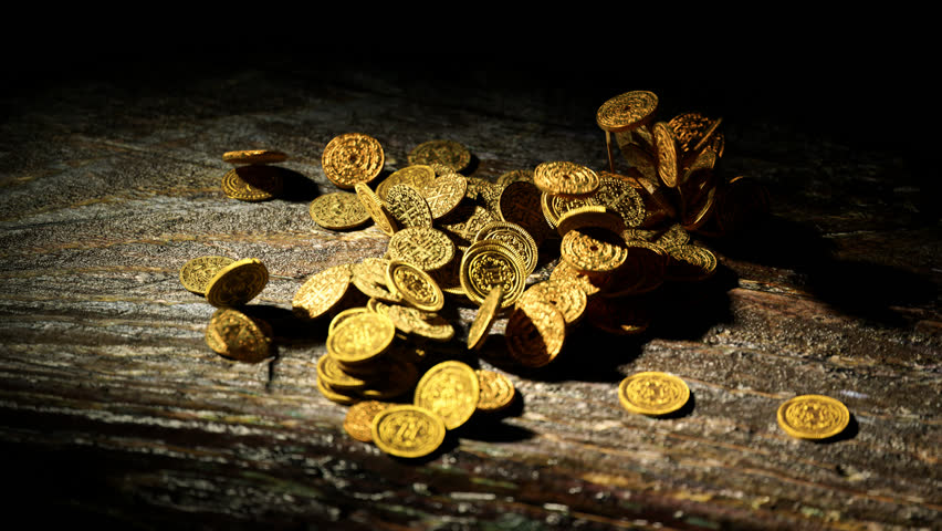 02866 Gold coins falling on the wooden table