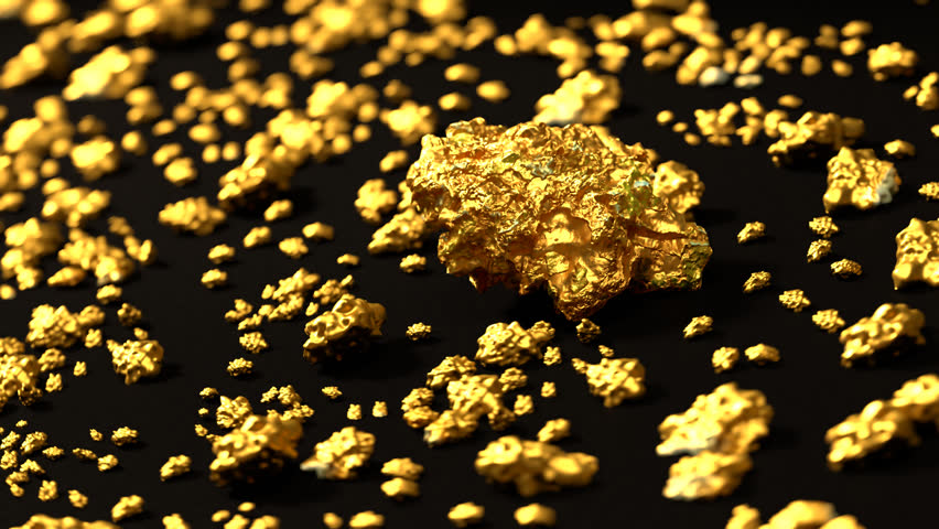 02850 Loopable footage of gold nuggets on round-table