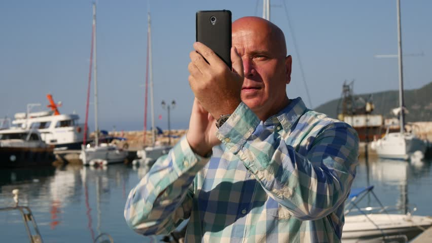 Satisfied Tourist Smile and Take Pictures in a Harbor Using Personal Cellphone (Ultra High Definition, UltraHD, Ultra HD, UHD, 4K, 3840x2160)