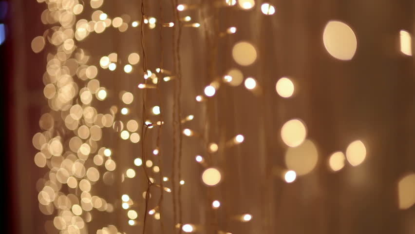 Christmas garland with Golden lights, close-up. Blurred Christmas lights. Bokeh.