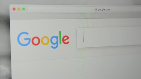 """Milan, Italy - July 6, 2017: Google.com homepage. Typing word """"business"""" in Google's search bar."""