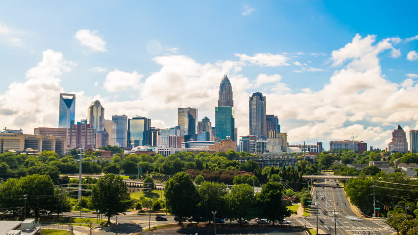 Charlotte skyline time lapse of clouds 4k 1080p - time lapse of downtown charlotte north carolina with traffic and clouds