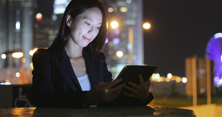Business woman using tablet computer at night  | Shutterstock HD Video #29064775
