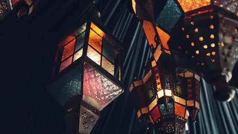 Arabic lanterns hanging under blue tent, close up