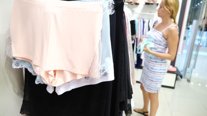 Women's panties on hangers in a sex store, 4k, slow motion