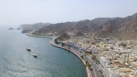 Aerial view of cityscape of Muscat, harbor and capital city of Oman, sultanate on Arabian Peninsula, 4k UHD
