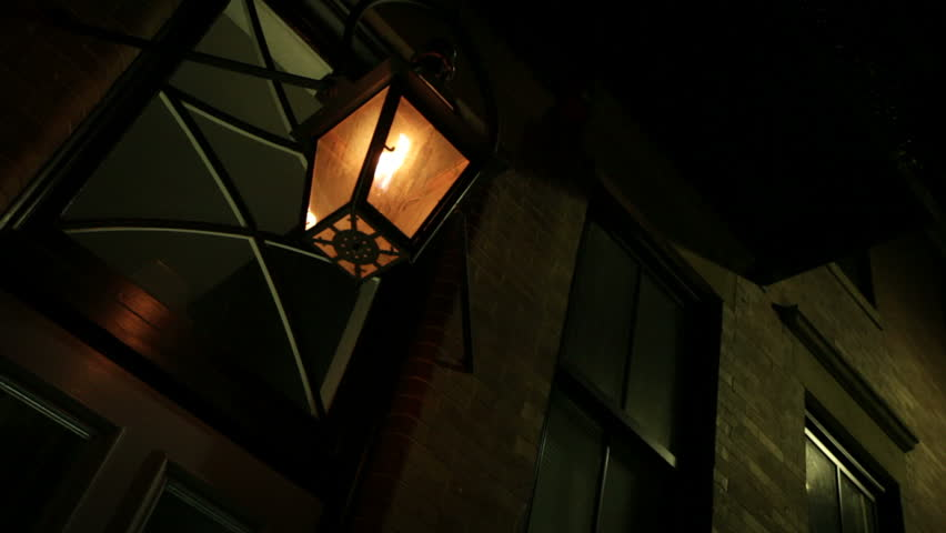A gas lamp burns in the old North End neighborhood of Boston
