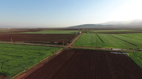 Bekaa Valley, Lebanon - 2017: drone camera tracking in on the wide green scenery of the bekaa valley