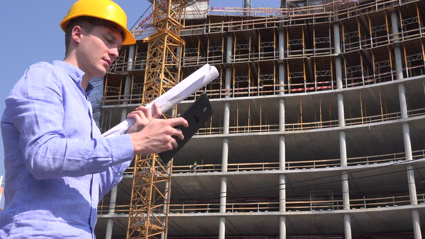 Architect Builder At Construction Site Workplace Check Building