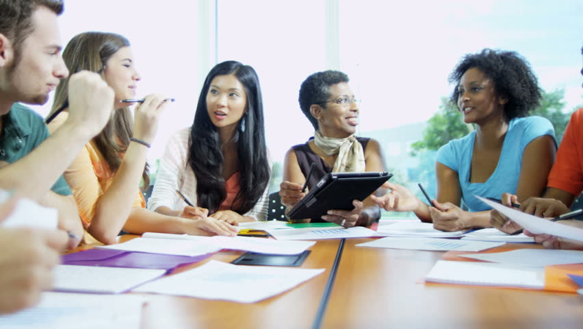 African American female college professor teaching class multi ethnic students working for academic diploma RED EPIC | Shutterstock HD Video #29155255