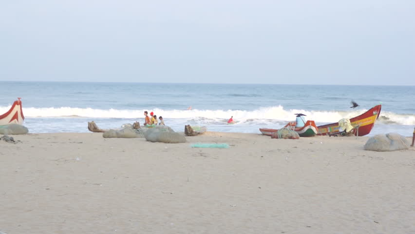 Mahabalipuram, India - 02.10.2014: Fishing boats on the beach at Mahabalipuram.
