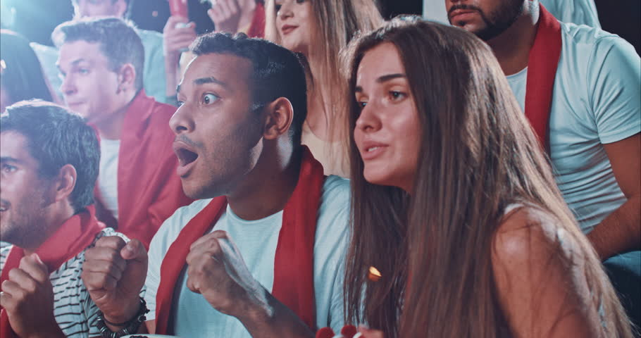 Group of fans watch a sport championship on stadium. People are dressed in casual cloth.   Shutterstock HD Video #29181145