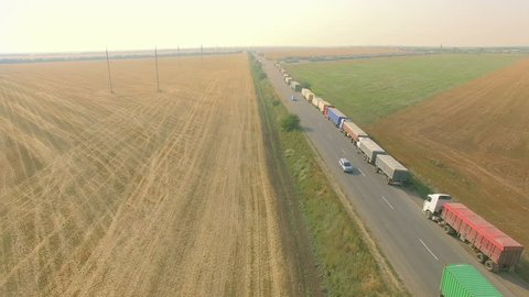 Overhead drone footage of transport network trucks shipping, supply chain