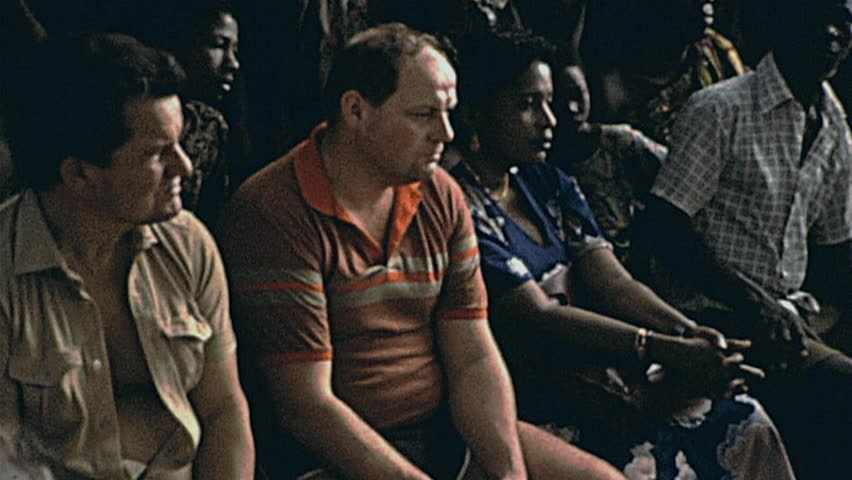 TOGO - 1985: european tourists watch a dance show in 1985 in Togo | Shutterstock HD Video #29233135