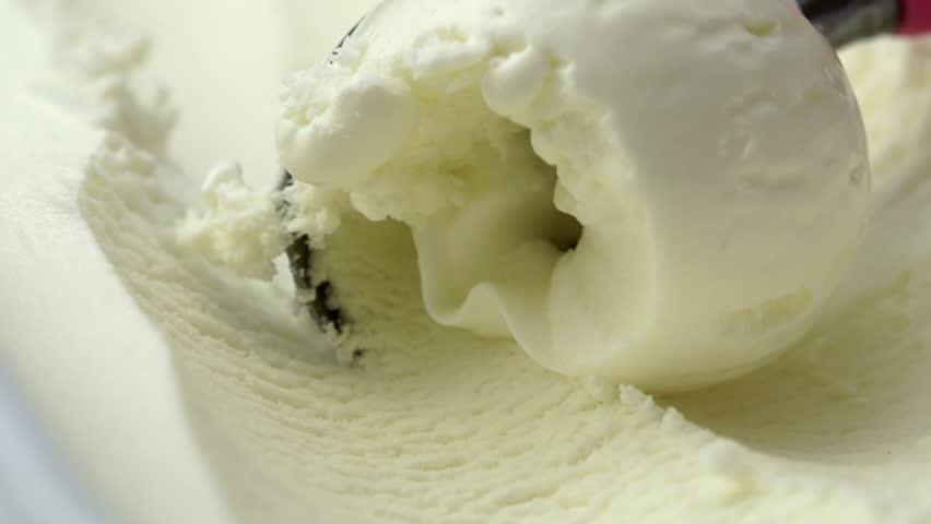 scooping vanilla ice cream close up (4K, HD, high definition 1080p).