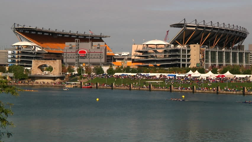 PITTSBURGH, PA - CIRCA OCTOBER 2009: Crew team members prepare and race in the Row Regatta on the Allegheny River on Pittsburgh's north shore.