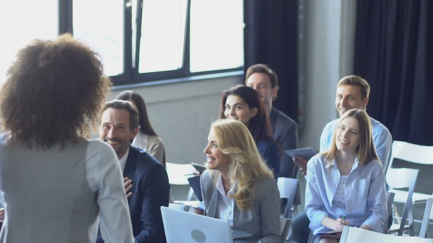 Happy Group Of Business People Listening To Businesswoman Leading Presentation At Seminar Talking Slow Motion | Shutterstock HD Video #29310865
