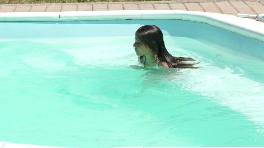 Little caucasian girl in the outdoor swimming pool, slowmo HD