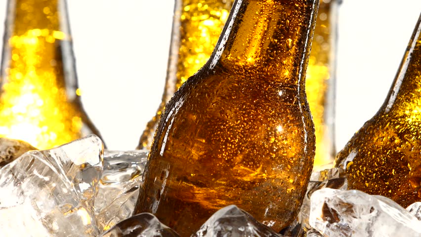 Festival of beer capacity are bottles of beer in the ice. White background. Close up